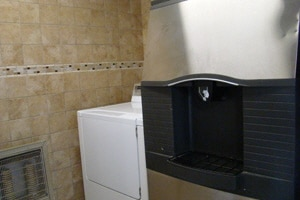 Ice machine and laundry amenities at Oak Square Condominiums